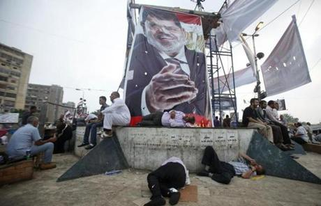 Morsi supporters slept in a Cairo square, underneath a large poster of the deposed president.