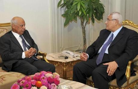 Egypt's interim president, Adli Mansour (right), met with newly appointed Egyptian Prime Minister Hazem el-Beblawi Tuesday at the El-Thadiya presidential palace in Cairo.