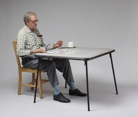"Duane Hanson's sculpture titled ""Old Man Playing Solitaire."""