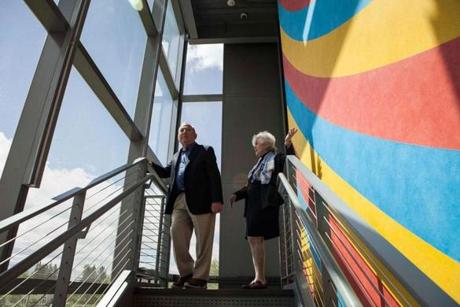 Peter and Paula Lunder took in the view on a staircase with Sol LeWitt'sWall Drawing #559, visible on the Colby campus.