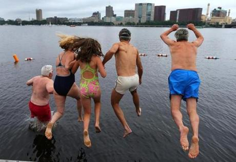 The Charles River Conservancy hosted the first public swim in the Charles River in 50 years, as participants took the plunge at a boat dock near the Hatch Shell on the Esplanade.