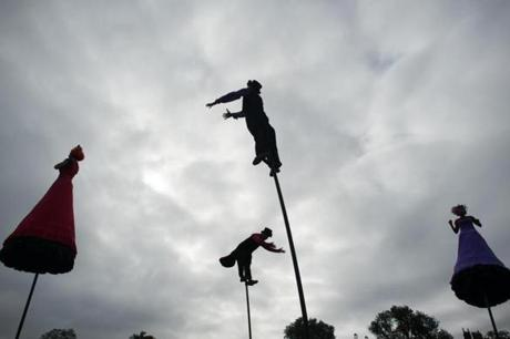 Members of Strange Fruit, from Melbourne, Australia, performed on tall poles during the Outside the Box Festival on Boston Common.