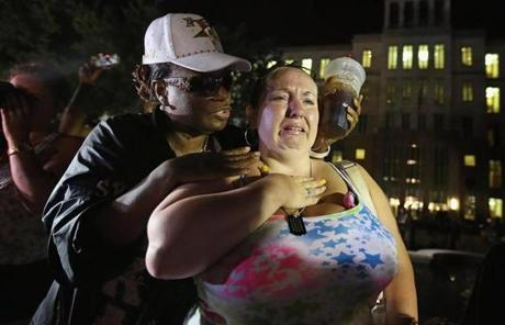 Kat Crowe (left) and Melinda O'Neal comforted each other in front of the courthouse in Sanford, Fla.