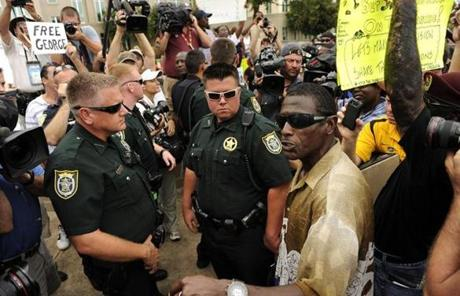 Demonstrator William Lee was asked by sheriff's deputies to step away from a group of Zimmerman supporters earlier in the day.