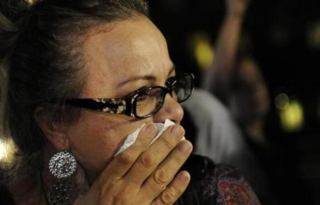 A woman wiped her tears in reaction to the verdict.