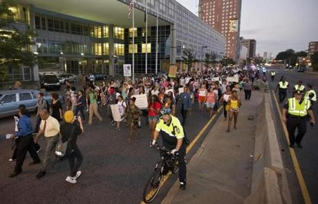 About 1,000 protesters marched past the Boston Police Headquarters.