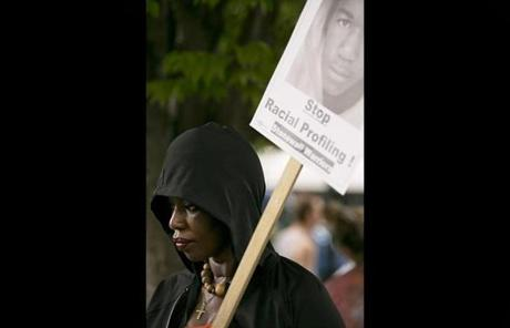 Cathy Guild, 47, of Roxbury held a sign and wore a hoodie in Martin's memory.