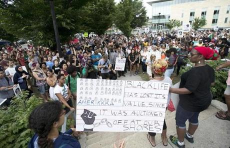 People of all races and ages gathered peacefully to show support for the teen's family.