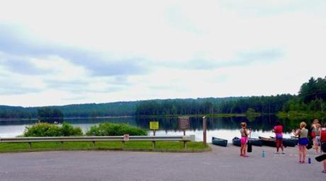 Young canoeists gathered at the boat ramp below the dam at Tully Lake Recreation Area.