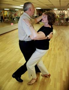 Nathan and Gloria Scollo demonstrated some of their moves at Steppin' Out Dance Studio in Lowell.
