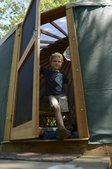 Alex explored the inside of a yurt at Peddock Island where he came with his family for an overtnight visit.