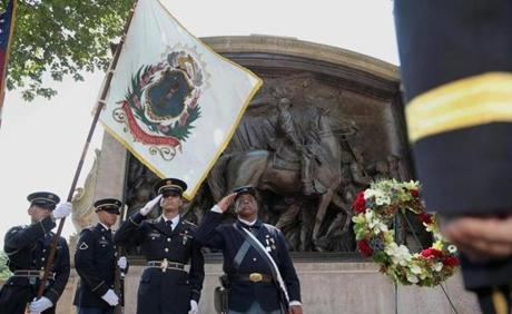 A wreath was placed in front of the Robert Gould Shaw Memorial opposite the State House in Boston to mark the 150th anniversary of the Battle of Fort Wagner in South Carolina, where members of the Massachusetts 54th Volunteer Infantry battled Confederate forces.