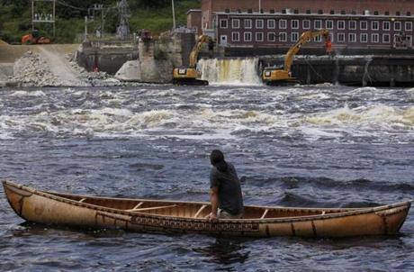 Joseph Dana watched from a traditional handmade birch canoe on the Penobscot River as the Veazie Dam was breached in Eddington, Maine.