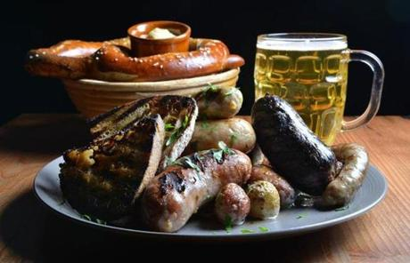 Bronwyn's Wurst Platter with sauerkraut, potatoes, bretzel, and Weihenstephaner hausbier.