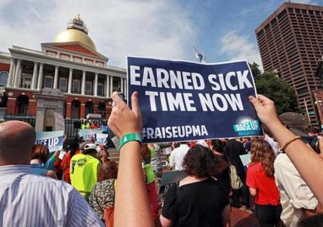 Supporters of proposed ballot initiatives to raise the state's minimum wage and require more employers to allow workers to earn sick days held a rally outside the Massachusetts State House.