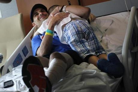 Boston Marathon bombing victim Marc Fucarile got a hug from son Gavin before leaving Spaulding Rehabilitation Hospital to head home to Reading. He is the last victim to leave a hospital following the attack.