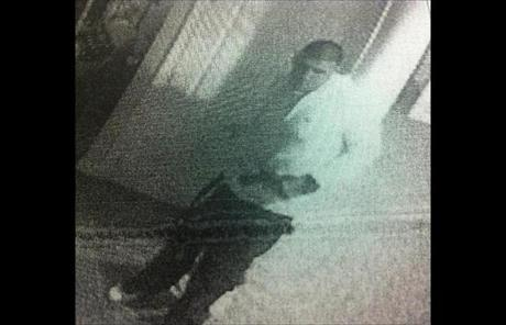 Hernandez appears to be holding the pistol by the barrel in this image.