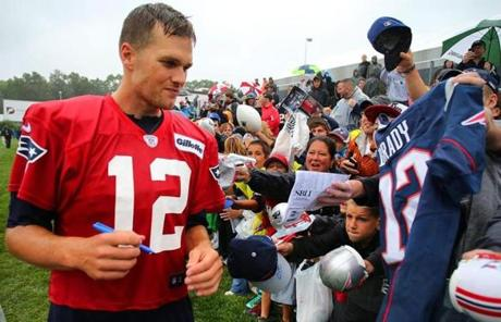 Patriots quarterback Tom Brady signed autographs for screaming fans at the end of camp.
