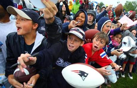 Fans yelled for autographs as Tom Brady approached after practice.