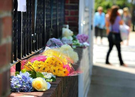 A memorial has sprung up outside Amy Lord's apartment on Dorchester Street in South Boston.