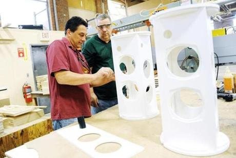 Whitinsville's A List Wood Works, where Brian Moore (left) and JimSpitz Nagel work, designs custom speaker cabinets.