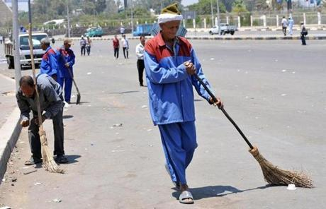 Municipal workers swept the street closed by supporters of deposed President Mohammed Morsi.