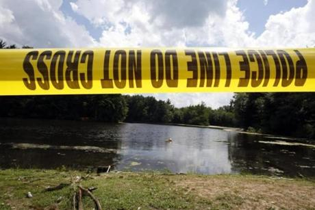 Police tape in front of Pine Lake.