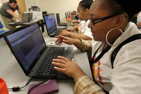 Constance Steed, 19, worked on fixing a broken video game during the Geek Squad Summer Academy.