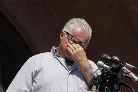 Steven Davis wipes away tears as he speaks to the media outside of the John Joseph Moakley Courthouse after a verdict was announced in the Whitey Bulger trial in Boston, Massachusetts August 12, 2013. (Jessica Rinaldi For The Boston Globe)