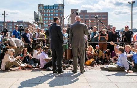 08/12/2013 BOSTON, MA Defense attorneys Hank Brennan (cq) (left) and J.W. Carney Jr. (cq) speak to the media outside the John Joseph Moakley United States Courthouse (cq) where the verdict was read in the case against James