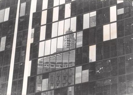 August 8,1973: The reflection of the old John Hancock building was fading as plywood replaced glass. More than 1700 panes - called