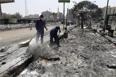 Government workers removed debris left behind when Cairo protest camps were razed.