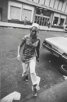 "Winogrand's ""Untitled (Woman Crossing Street, New York),"" (circa 1970) from the exhibit ""Winogrand's Women Are Beautiful."""