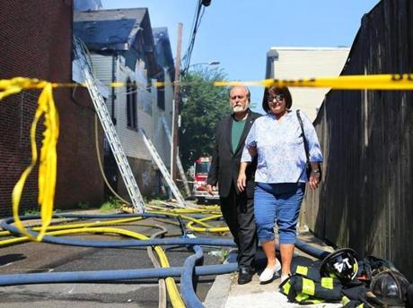 Chancellor of the Diocese, the Rev. Arthur Liolin, and church board member Cindy Vasil Brown. looked at the damage to the church.