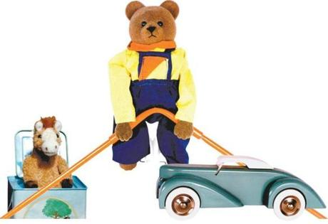 Among the Schylling classics: Talking Pony Musical Jack-in-the-Box, Earnest the Bear, and a vintage wooden car.
