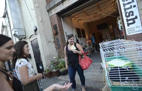 Laura Moran (from left), Maria Robilotto, and Nina Nocciolino remarked on the pet rabbit outside of Relish, which sells wares for urban agricultural needs.