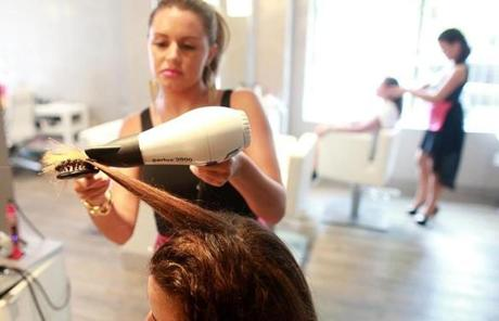08/22/2013 Boston Ma; Blo ,Blow Dry Bar hairstylist Amanda Gurdjian (cq) with client Cyd McKenna (cq) in the South End.( Jonathan.Wiggs )Topic:Section:Reporter: Topic: Reporter: