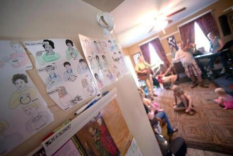 Sign language charts at the home of Jeanne and Andy Nadeau, who are preparing should their five children who suffer from hearing loss eventually become deaf.