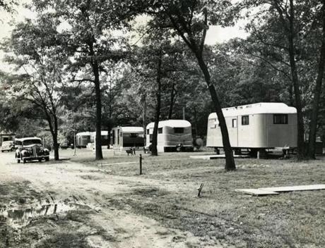 September 15, 1946:  At Lake Walden in Concord, in the wooded sections Thoreau had made famous, trailer dwellers developed a community called Walden Breezes. Located across the road from the pond, the 5-acre camp opened in the 1920s and, in its heyday, was home port to more than 80 trailers, clustered under spreading trees, with a laundry shack and snack bar. The state bought the land in 1976 and under the terms of the agreement, no new arrivals were permitted. Residents were given lifetime tenancy and the last tenant, Edna Toska, left the park in 2008 after 32 years of living by the pond.