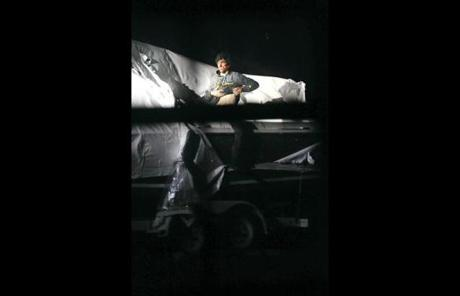 Tsarnaev lifted his shirt as he stood up in the boat where he had been hiding.