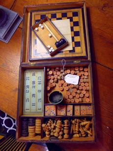 A tabletop game set is among the items for sale at Margaret Doyle Antiques in Essex.