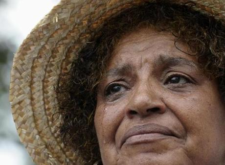 Sandy Redman of Pine Top, N.C., cries as she listen to President Barack Obama speak at the Lincoln Memorial in Washington, Wednesday, Aug. 28, 2013, during the anniversary of March on Washington. Redman attended the first march 50 years ago. (AP Photo/Susan Walsh)