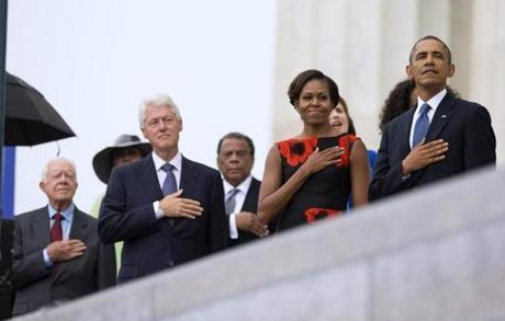 From left, former President Jimmy Carter, former President Bill Clinton, former United Nations Ambassador Andrew Young, first lady Michelle Obama, and President Barack Obama stand for the national anthem during a ceremony commemorating the 50th anniversary of the March on Washington, Wednesday, Aug. 28,2013, at the Lincoln Memorial in Washington. The president was set to lead civil rights pioneers Wednesday in a ceremony for the 50th anniversary of the March on Washington, where Dr. Martin Luther King's
