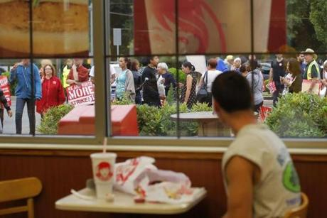 Strikers and supporters marched outside a Wendy's restaurant in Boston Thursday.
