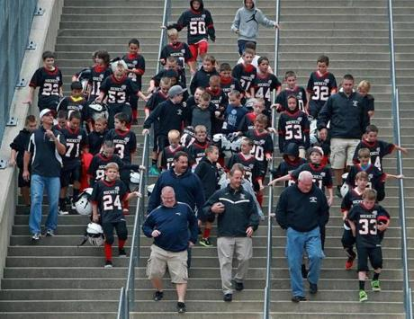 A youth football team from Reading came down the stairs en masse as they headed for Gillette Stadium, where the Patriots played the Giants.