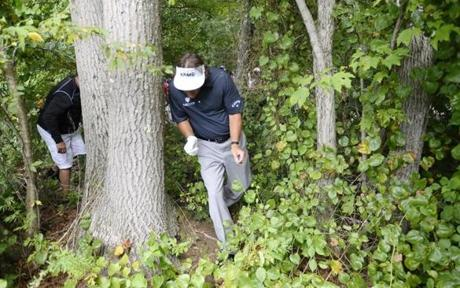 After a wayward tee shot on No. 9 (his final hole), Phil Mickelson had to poke a shot out the woods. He made bogey to finish at 63.