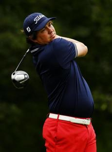 Jason Dufner, recent winner of the PGA Championship, tees off on the fourth hole. He shot a 5-under 66.