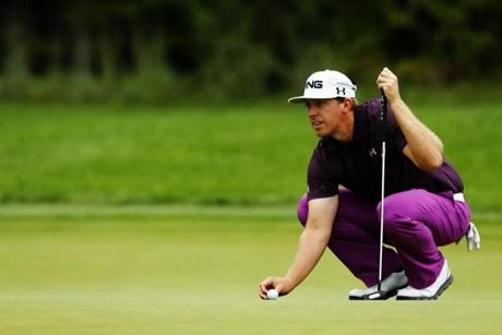 Sporting stylish purple pants, Hunter Mahan lines up a putt on the third green. He shot a stylish 65.