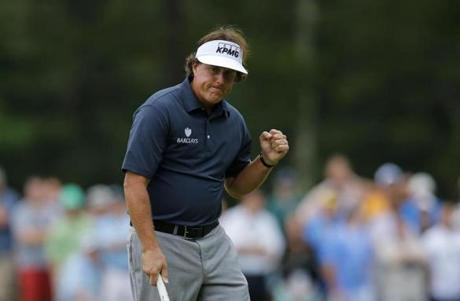 It was indeed a fist-pumping day for Phil Mickelson, who will share the lead heading into the second round.
