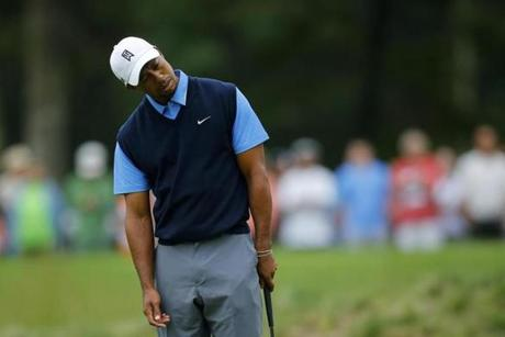 Tiger Woods looks askance after missing a birdie putt on 14.